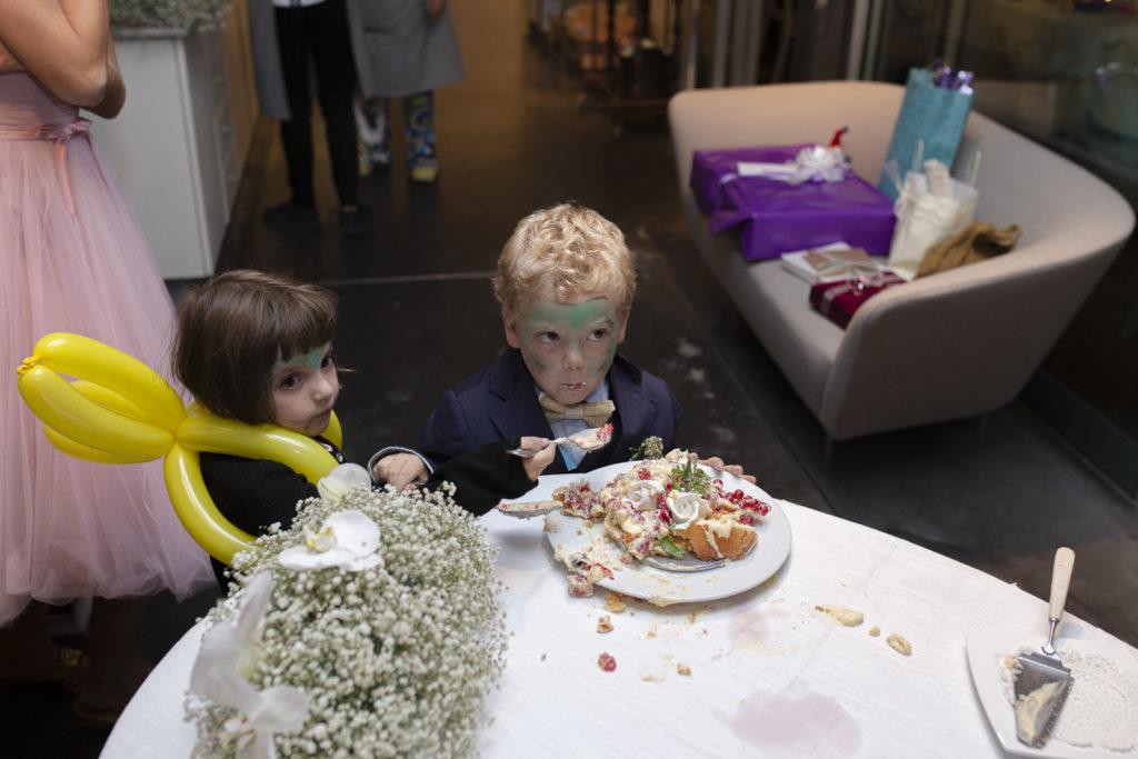 child and wedding cake